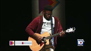 Guitars Over Guns' Rody Lafrance performs during My Future My Choice town hall
