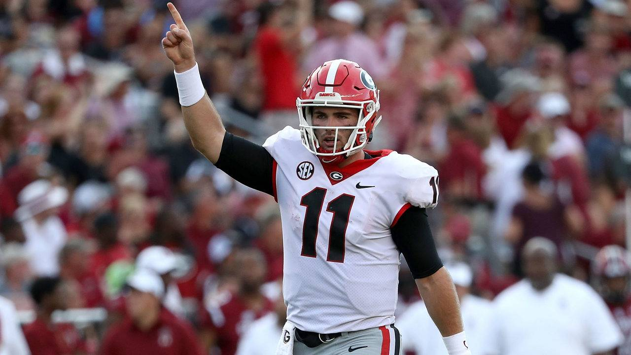 50b0d1050 Jake Fromm  11 of the Georgia Bulldogs reacts after a touchdown against the  South Carolina Gamecocks during their game at Williams-Brice Stadium on ...