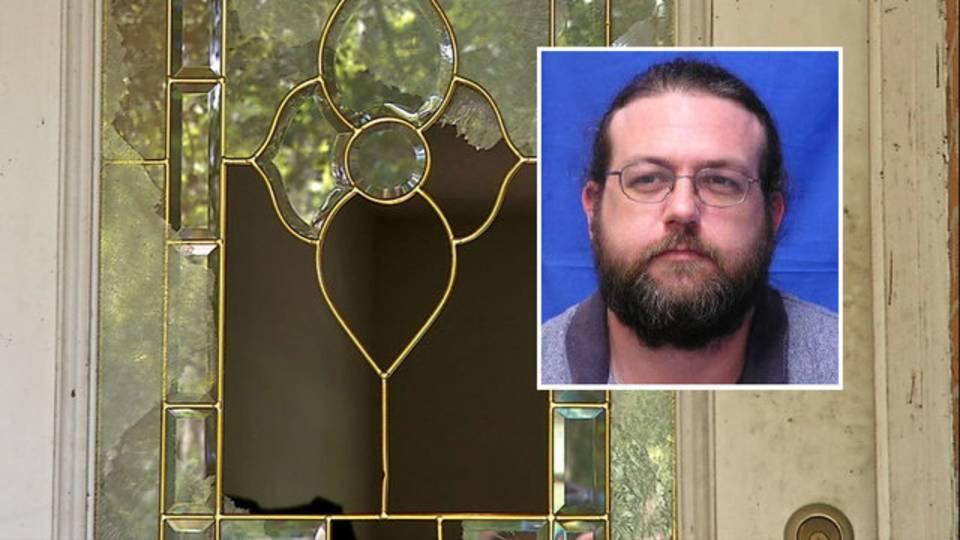 Joe Brenton on shattered glass door