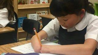 Girl born with no hands wins national handwriting competition