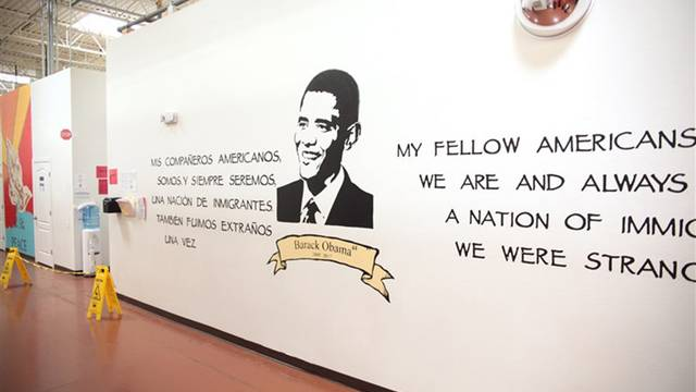 The mural of President Barack Obama in the Casa Padre immigrant shelter in Brownsville, located in a store that was previously a Walmart.