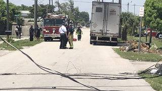 1 hurt after tractor-trailer gets snagged on power lines, topples utility pole