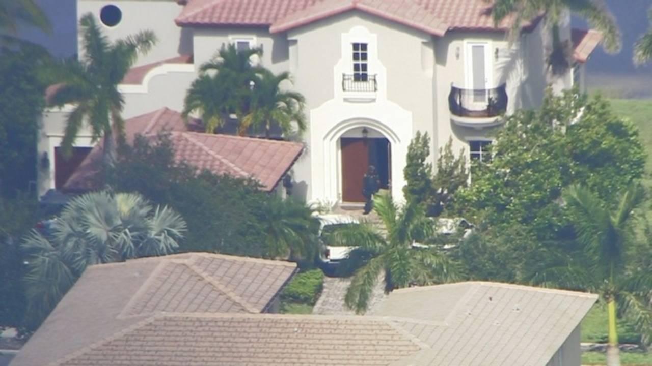 Deputies going inside David Hogg home
