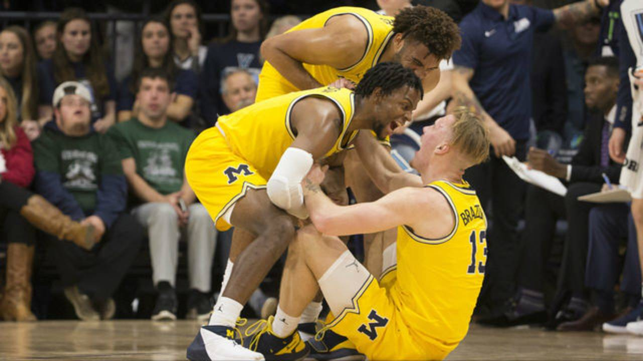 Ignas Brazdeikis, Zavier Simpson and Isaiah Livers Michigan basketball vs Villanova 2018