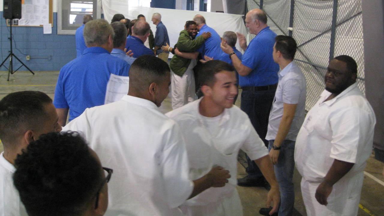 kolbe-prison-retreat-hugging_1549496116416.jpg