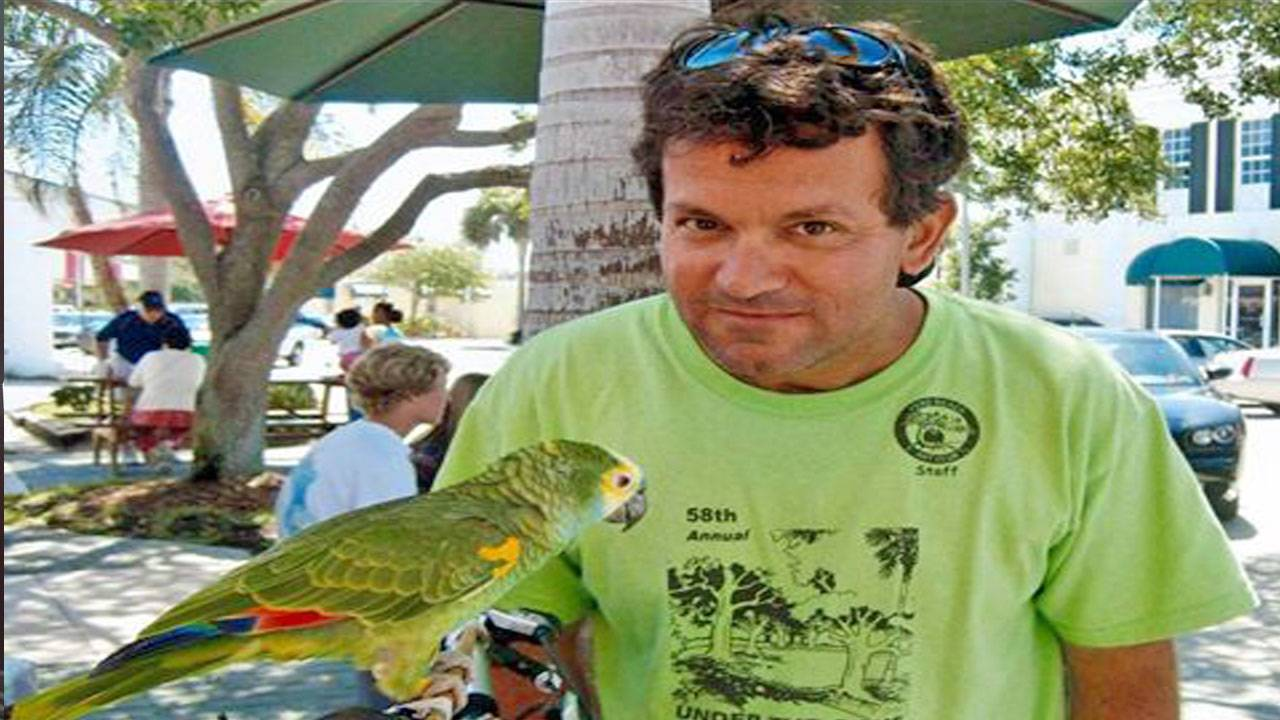 Mike Blatus and his parrot