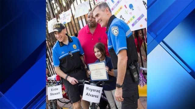 Nayaraq Alvarez awarded bike by Miami Beach police