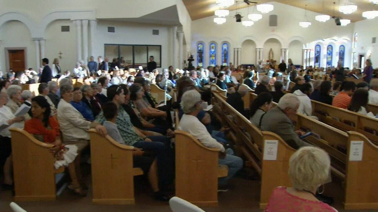 Vigil for slain priest held in St  Augustine