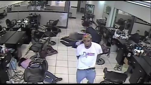 Police search for man accused of violent hair salon robbery