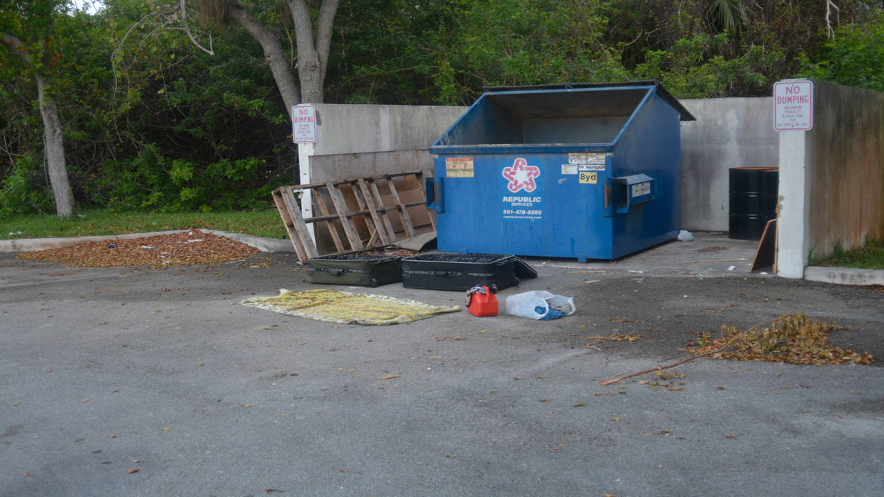 Dumpster and suitcase containing bloody clothing that James Scandirito was seen dumping