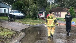 PHOTOS: Neighbors alert women to flee a burning house in NE Houston