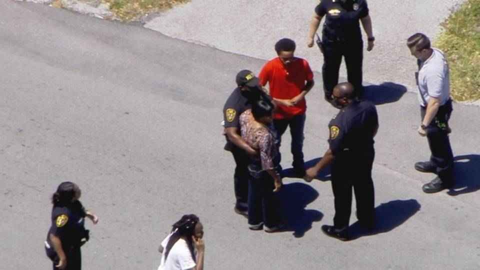 Sky 10 over police speaking to people in North Miami