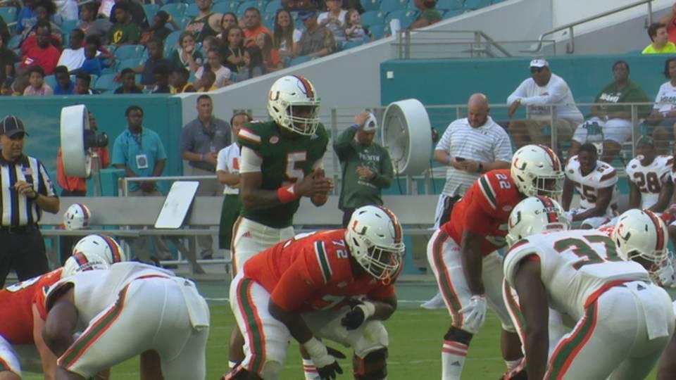 Miami Hurricanes quarterback N'Kosi Perry takes snap during spring game