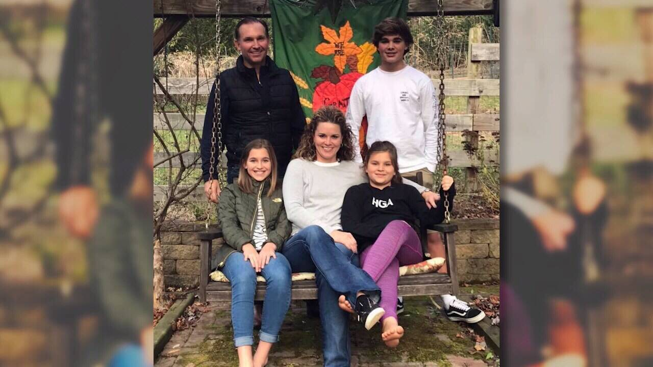 Curry family photo on swing_1551107458366.jpg.jpg