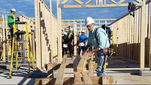 Volunteers work to put sheathing, hurricane clips on new Habitat Home