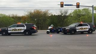 2 pedestrians hit by car while crossing street, police say