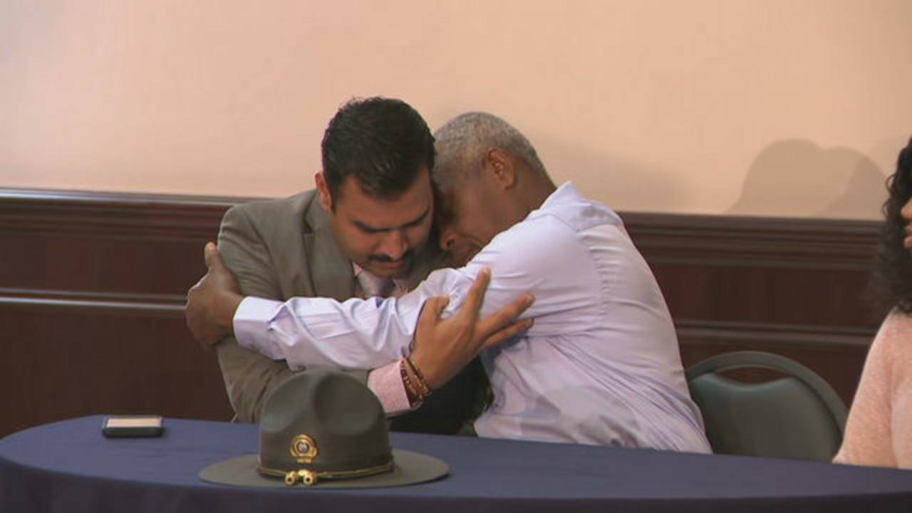 FHP Trooper Mithil Patel and Rony Bottex, man he saved, embrace