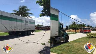 Low-hanging power lines become entangled with tractor-trailer