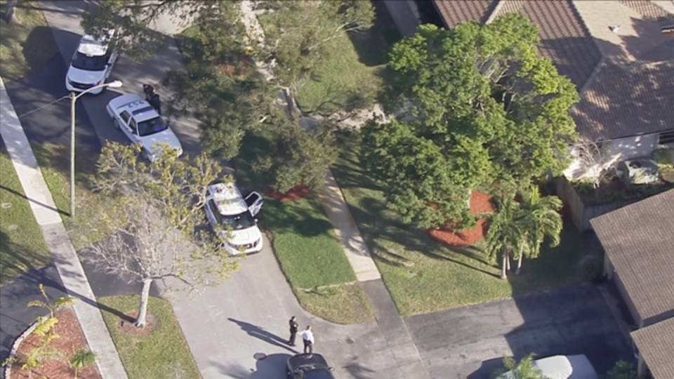 Police outside home burglarized in Plantation