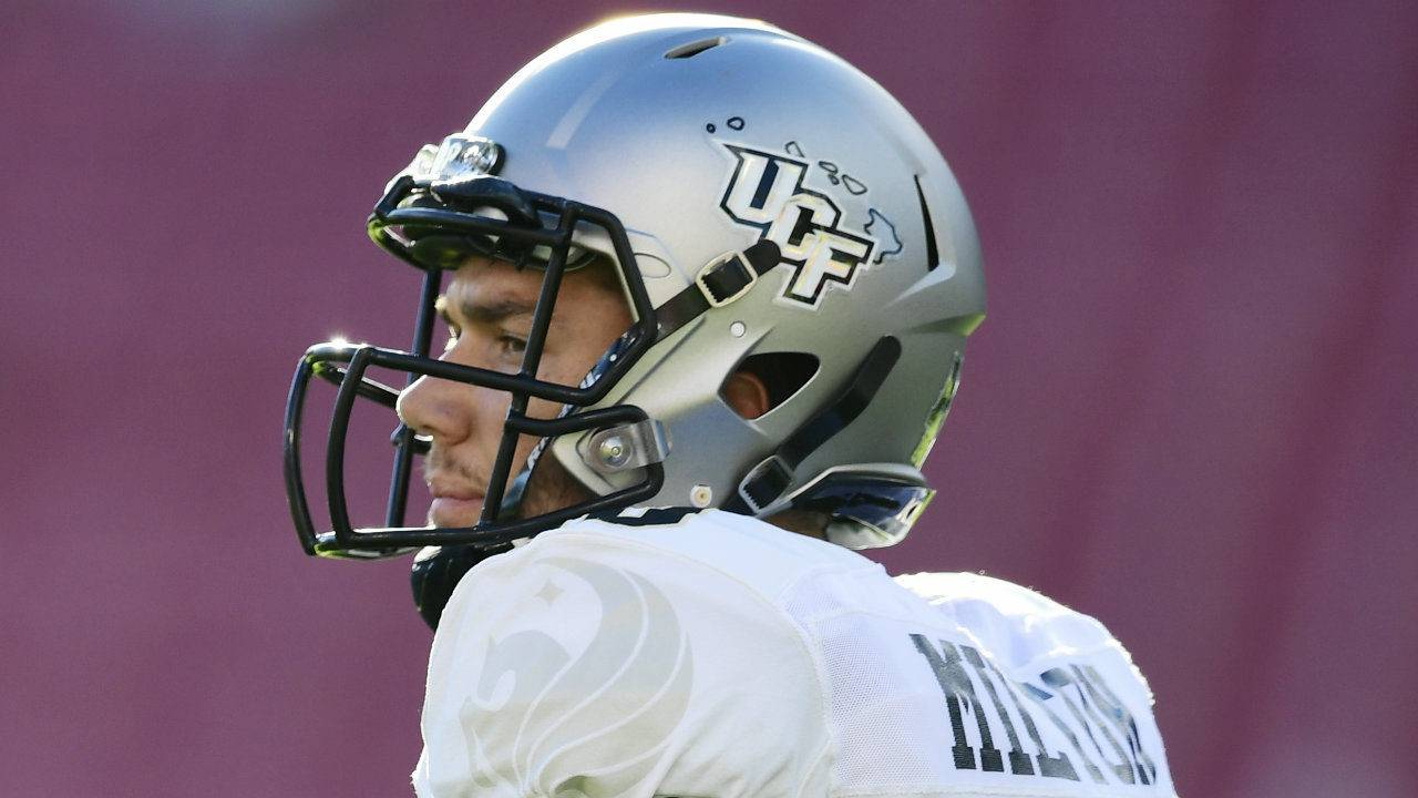 UCF QB Milton carted off field in first half against South... 8ba70657e