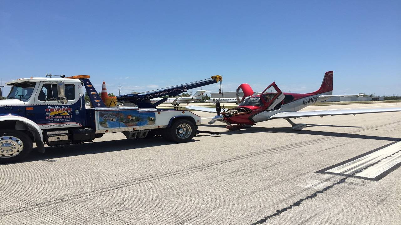 Small plane being towed in Marathon