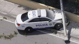 Pole crashes down on Doral police cruiser during wreck