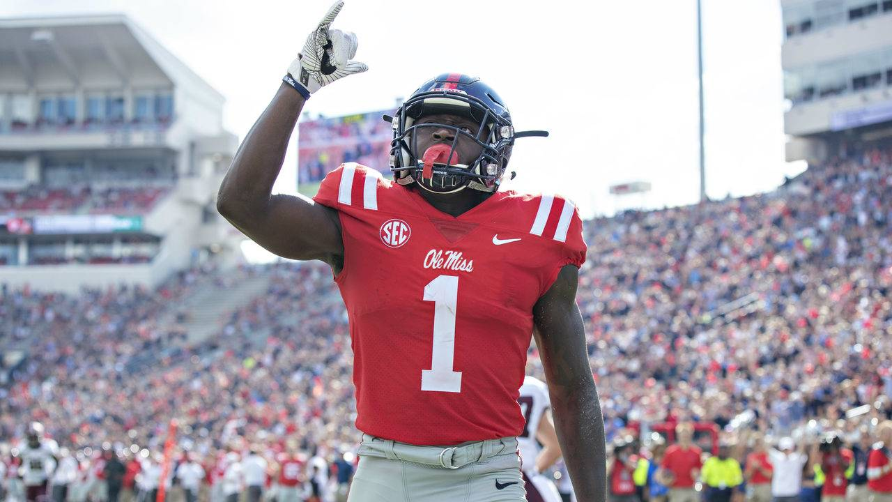 A.J. Brown  1 of the Mississippi Rebels points to the sky after scoring a  touchdown against the Southern Illinois Salukis during the first half at ... aed262c5c