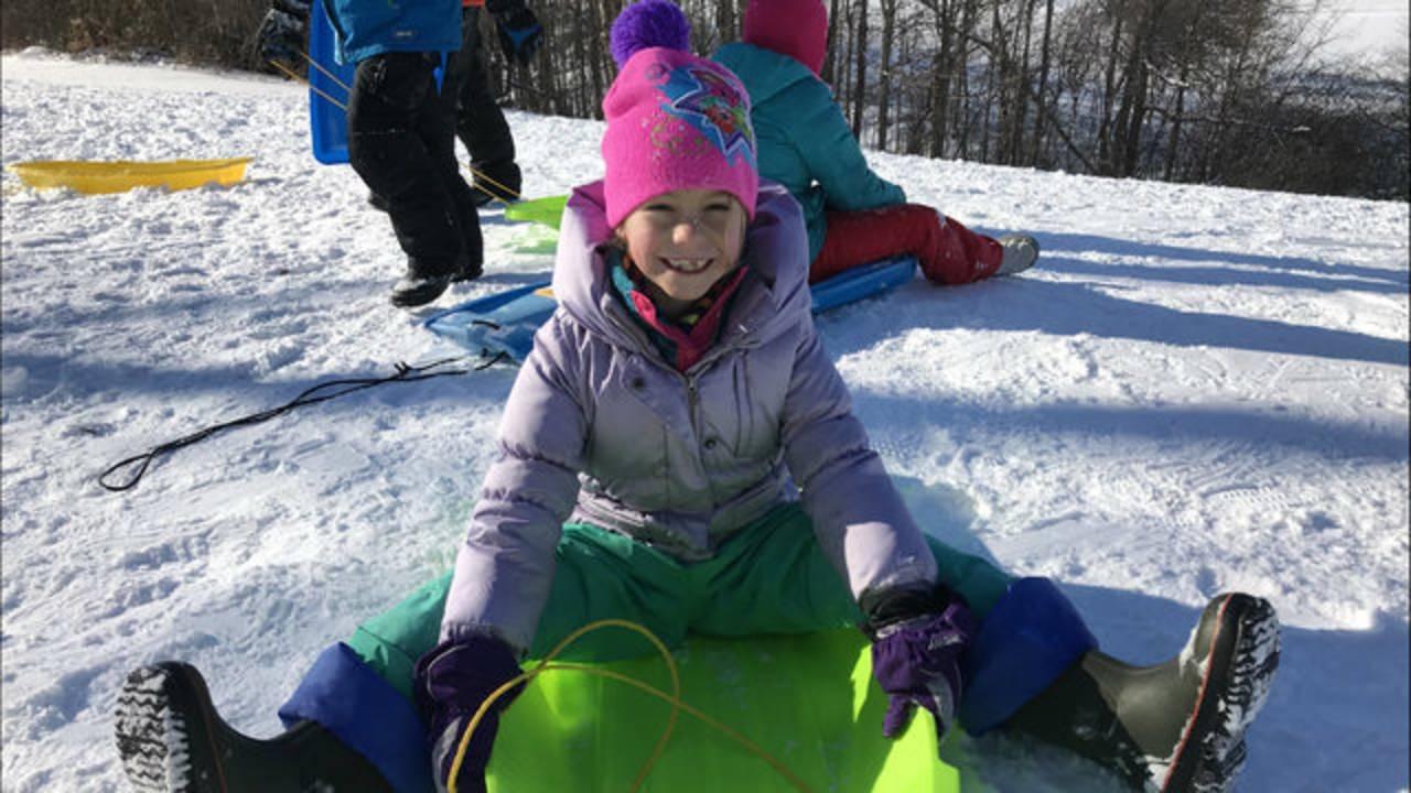 Girl sledding