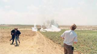 CNN news crew witnesses tear gas being dropped on protesters in Gaza