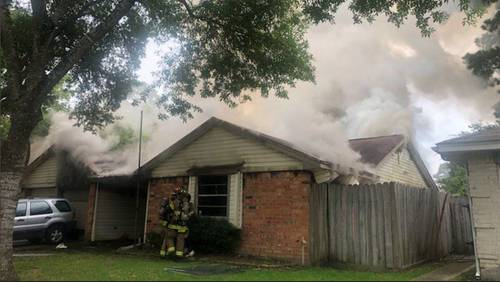 Woman severely burned in Spring house fire dies, officials say