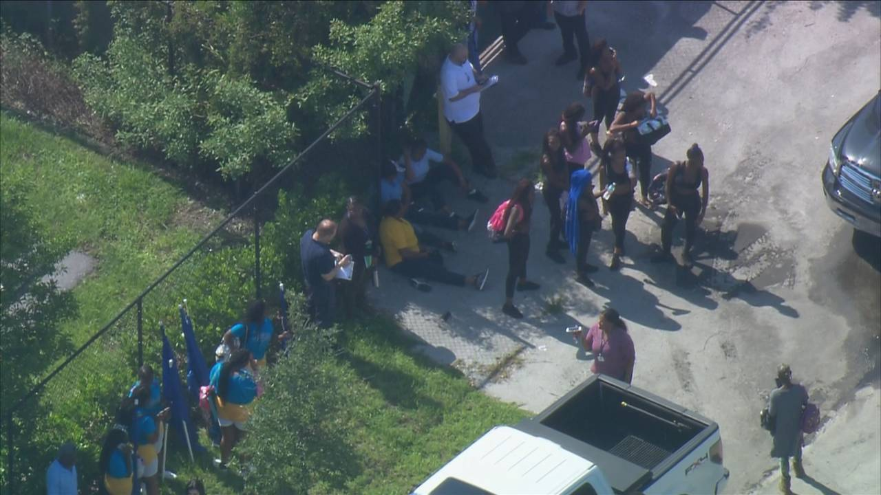 People standing outside Miami Northwestern