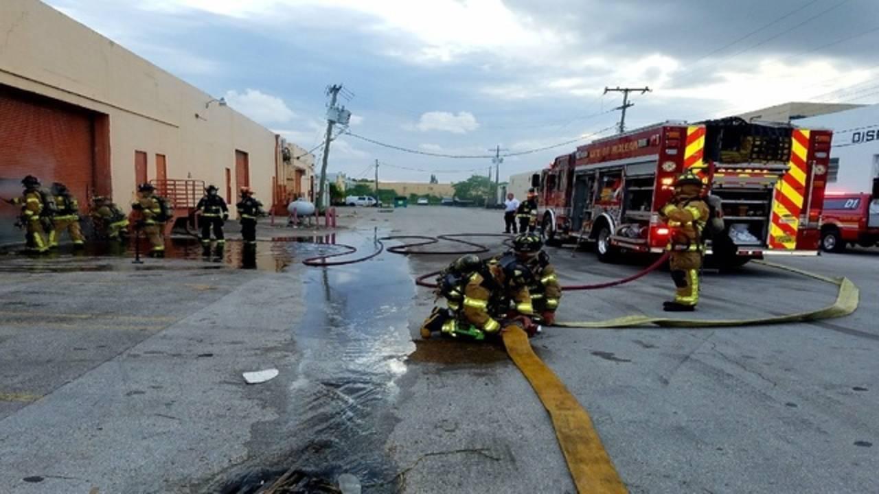 firefighters working warehouse fire near Hialeah