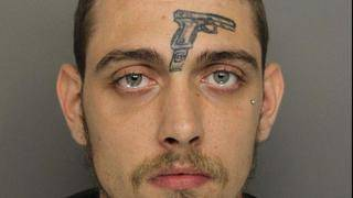 Man With Gun Tattoo on His Forehead Arrested on Firearms Charge