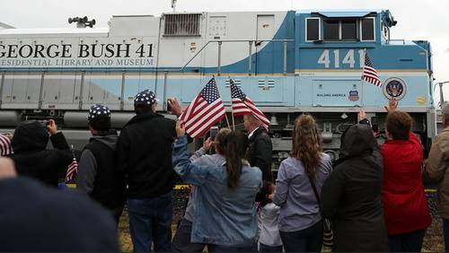 Thousands pay respects as 4141 train carrying Pres. George H.W. Bush passes by