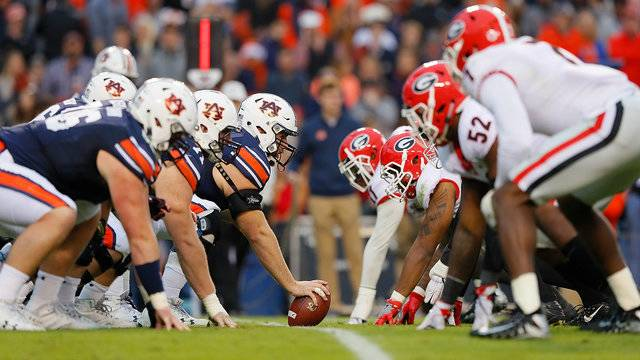 The Auburn Tigers Offenses Prepares To Run A Play Against Georgia Bulldogs Defense At Jordan Hare Stadium On November 11 2017 In Alabama