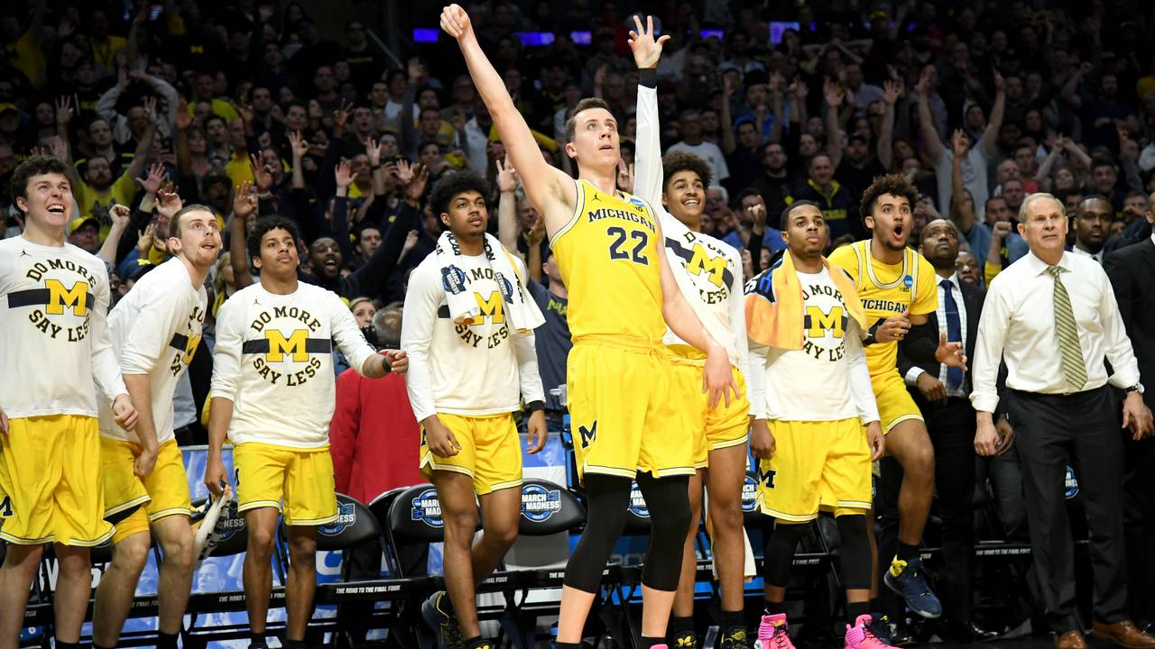 9d9ec77f7eb Duncan Robinson  22 of the Michigan Wolverines reacts in front of the bench  as he makes a three-pointer in the second half while taking on the Florida  State ...