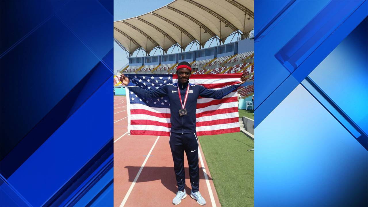 Tyrese Cooper holding American flag