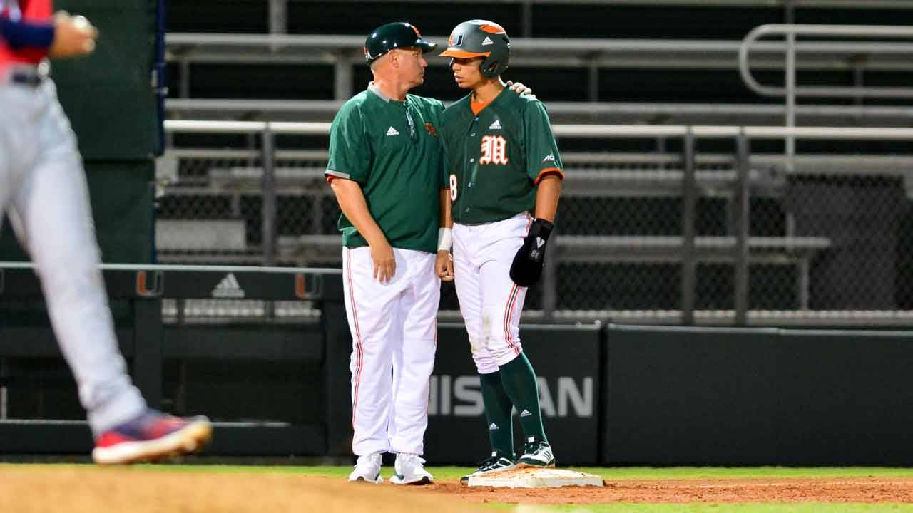 Miami Hurricanes head baseball coach Gino DiMare speaks to Luis Tuero vs. FAU Owls
