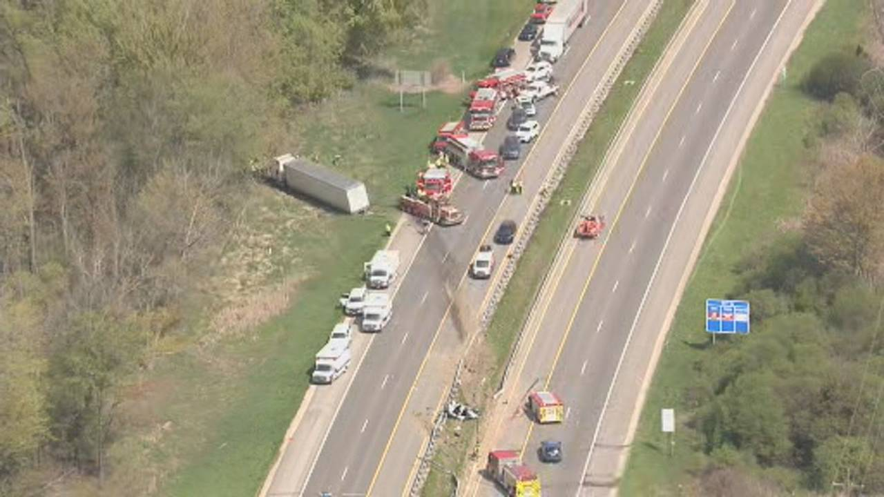 Semi truck hits car, crosses median, slams into pickup on US