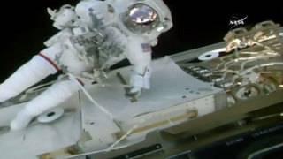 NASA astronauts conduct spacewalk to shuffle pumps