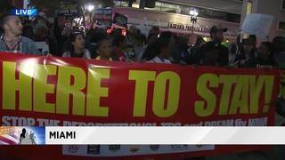 Amid budget fight in Washington, immigration advocates march in downtown Miami