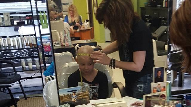 Jania Hernandez getting measured for wig