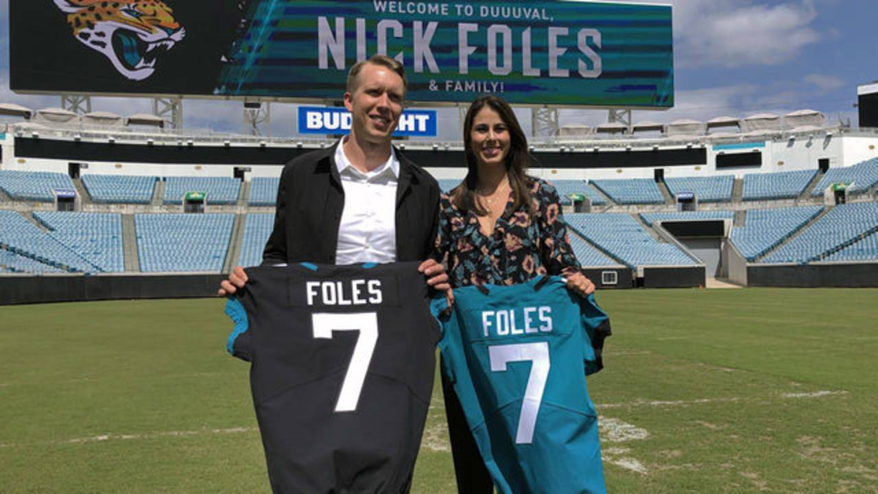 Nick Foles and wife, Tori on field