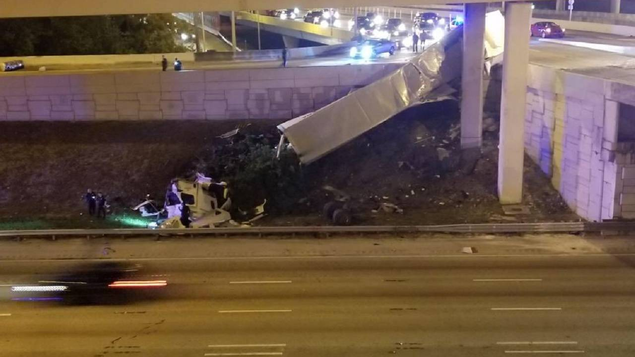 18-wheeler dangling off ramp on I-95