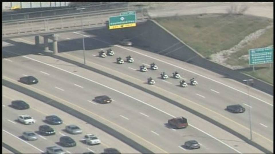 11 DPD motorcycle officers driving away from I-96 crash scene