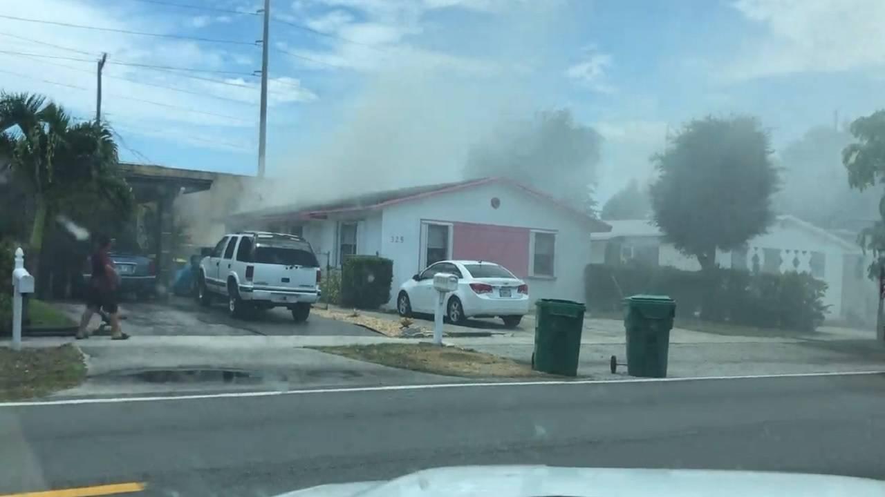 Smoke coming from duplex in Deerfield Beach