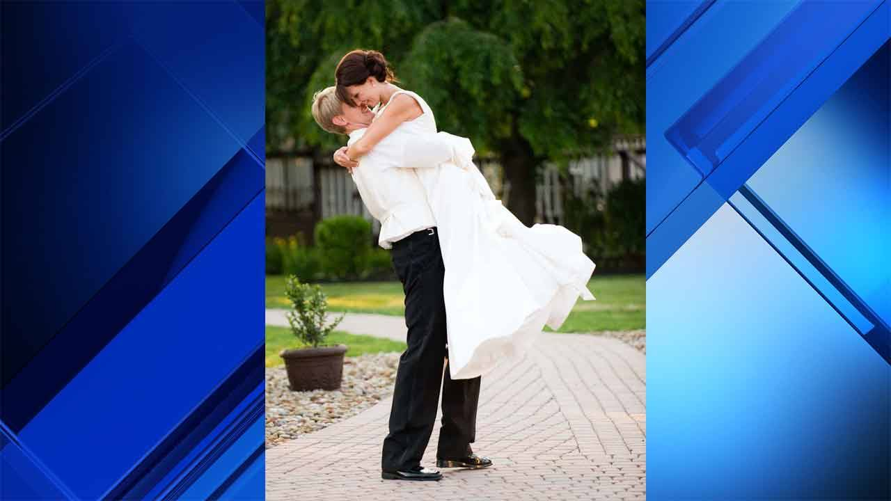 Clay Ferraro and wife Kristen on their wedding day background