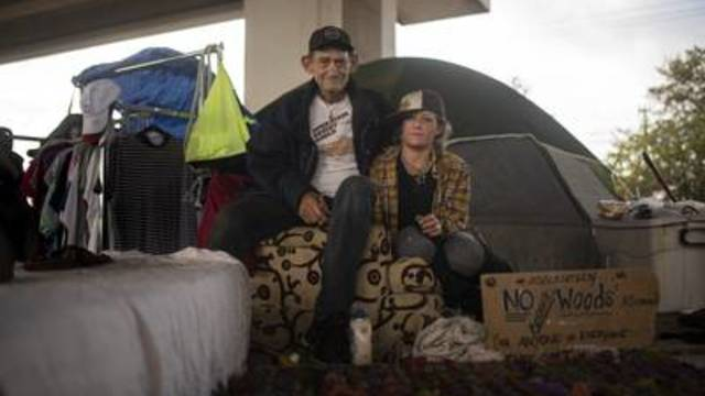 Harvest (right) lives under a State Highway 71 overpass. Herman Rux, who was homeless in the 1980s, still visits encampments.