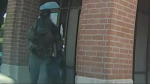 Dashcam video shows armored truck guard being ambushed by robbers at bank near West U