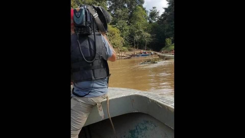 allen on river borneo_1512585600599.jpg